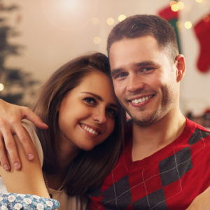 Picture of young couple hugging in Christmas time